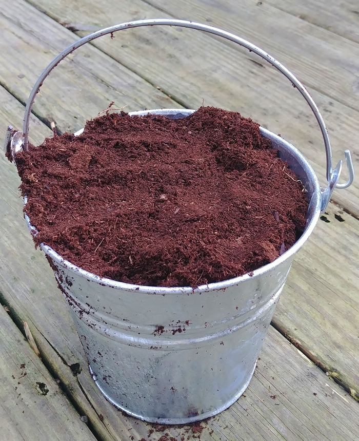 galvanized bucket of peat moss