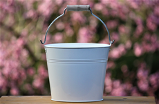 white metal pail with handle