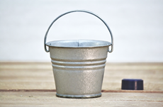 small silver metal bucket